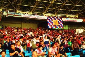 Indonesian football fans watching Indonesia play Uruguay