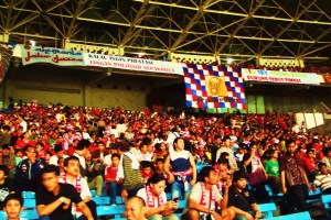 Indonesian football fans watching Indonesia play Uruguay